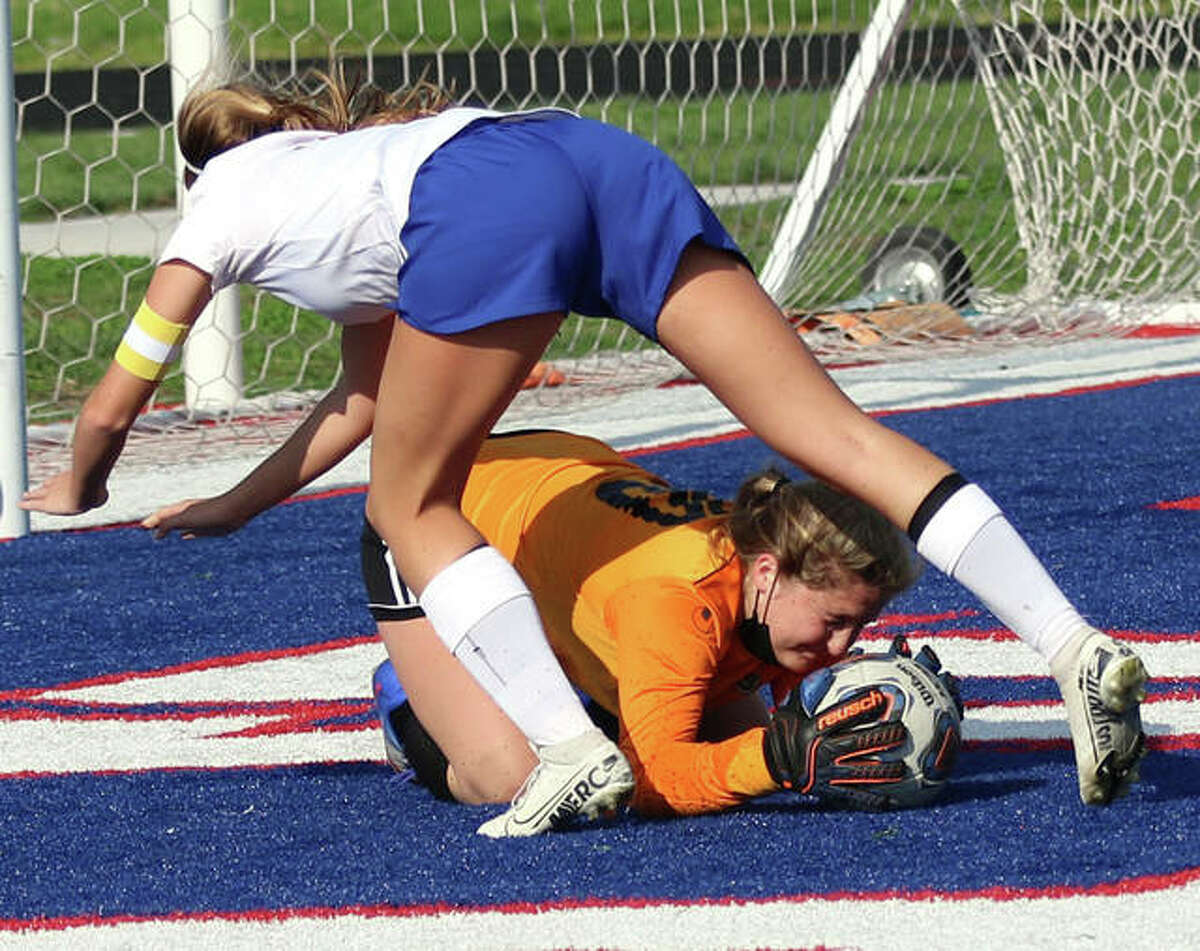 Carlinville goalie Mitilda Mitchell (bottom) beats Roxana's Macie Lucas to the ball during a SCC girls soccer April 29 in Carlinville. On Monday in Virden, Mitchell made six saves in the Cavaliers' 2-0 loss to North Mac.