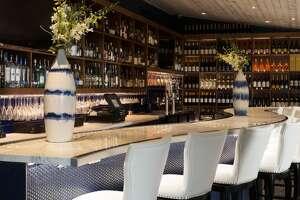 The bar at popular brunch spot A'bouzy, nestled in Houston's River Oaks.