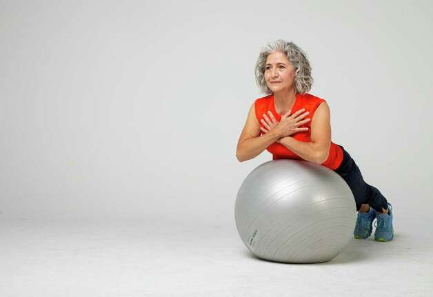 Shana Ross demonstrates back extensions inside the Houston Chronicle photography studio on Wednesday, April 21, 2021, in Houston. Photo: Godofredo A. Vásquez, Houston Chronicle / Staff Photographer / © 2021 Houston Chronicle