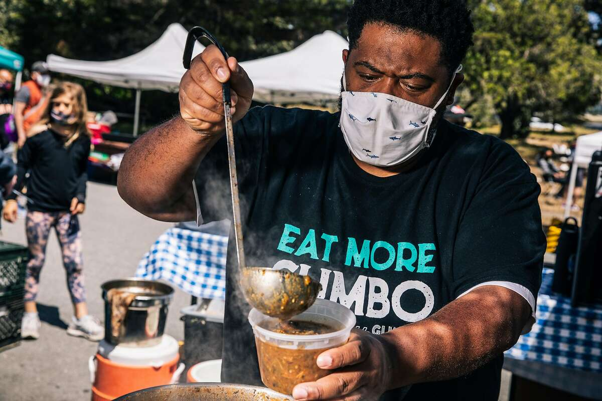 Dontaye Ball, owner of Gumbo Social, makes chicken-sauage gumbo at the Outer Sunset farmers' market.