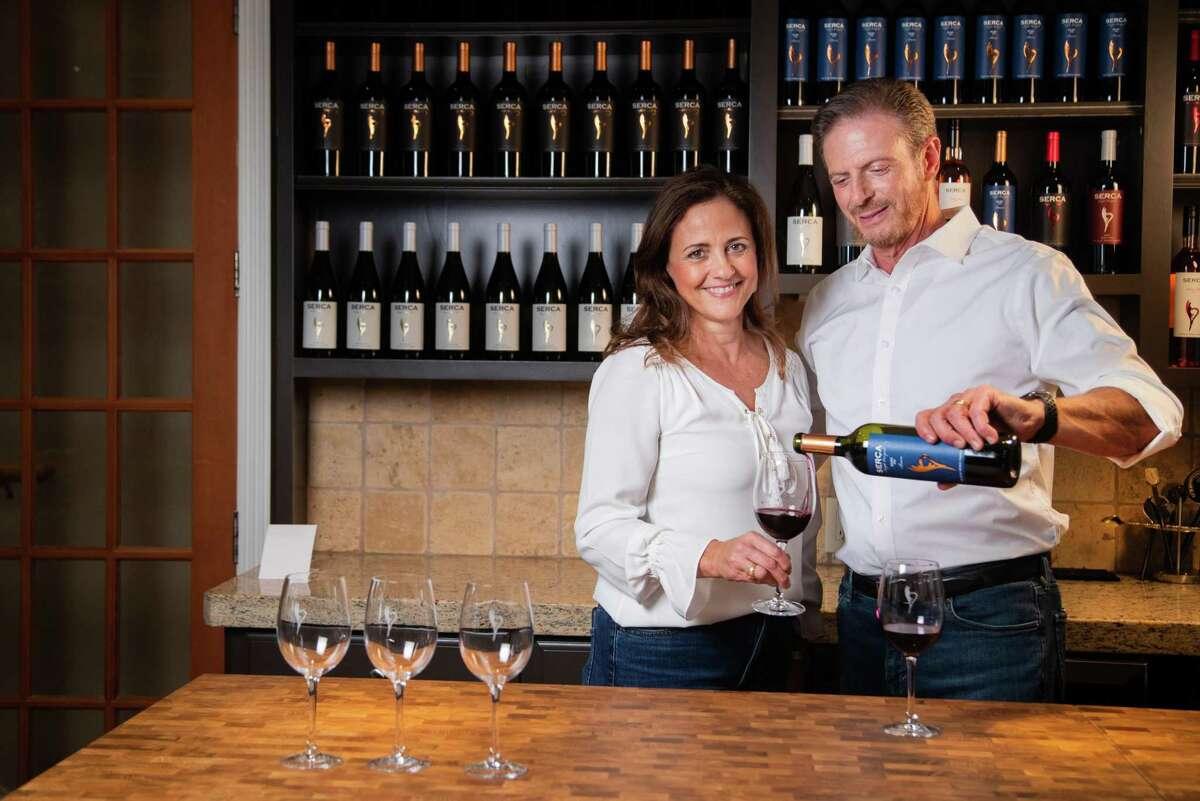 Serca Wines owners Carolina Weitzman and her husband Sergio Weitzman in their Heights wine tasting room