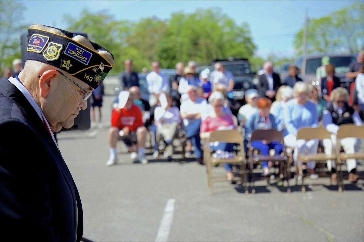 """Vietnam veteran Tom Quinn of Fairfield takes part in a moment of silence at the annual """"To Those in Peril on the Sea"""" ceremony at South Benson Marina on Saturday, May 25, 2019, in Fairfield, Conn."""