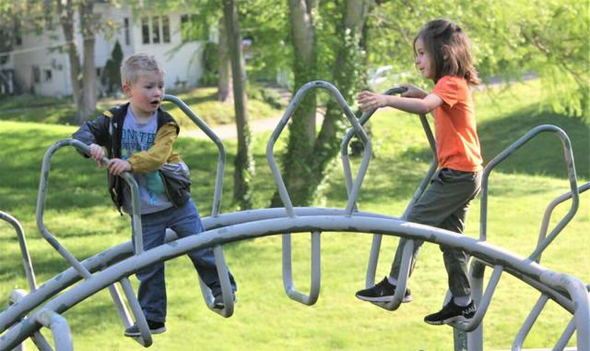 Hayden Griffin, left, and Emerson Heifchmidt work their way across one of the pieces of playground equipment at Haskell Park Wednesday morning. The two were part of a preschool class at St. Mary's Catholic School that took a field trip to the park. Because of the coronavirus, it was one of the few field trips they were able to take this year.