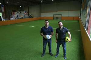 Zweatit owners Jacobo Rivera, 36, left, and Alejandro Campos, 33, at their indoor soccer field at 207 W. Cevallos St.