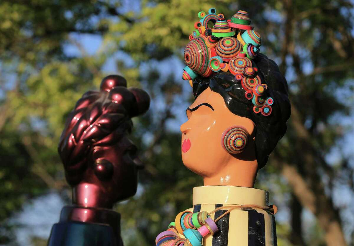 """Botanical Fridas,"" sculptures depicting artist Frida Kahlo, are on display at the San Antonio Botanical Garden. They are part of ""Frida Kahlo Oasis,"" a new exhibit."
