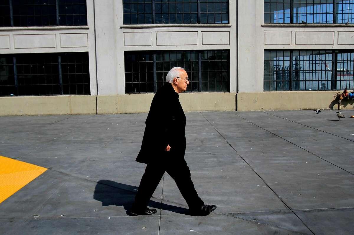 Alessandro Baccari, 84, walks along the wharf in 2012.