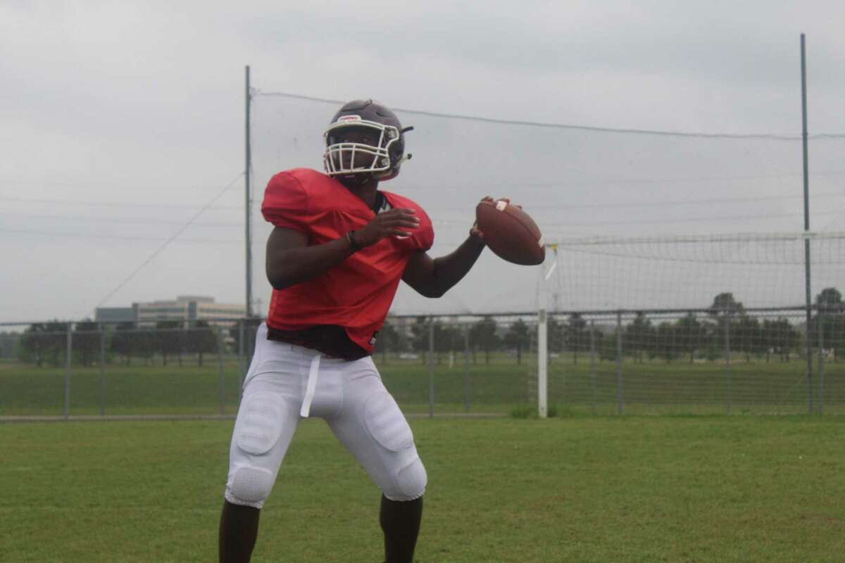 Summer Creek quarterback Jahrik Jones working with wide outs during practice.