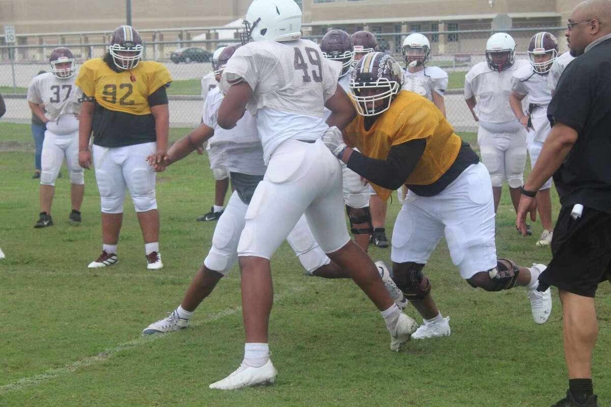 Summer Creek offensive lineman Kelvin Banks Jr. working through drills at practice.