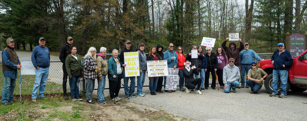 Lee Township residents gather at the Lee Township Solid Waste Transfer Station Wednesday, May 5, 2021 in protest of the Lee Township Board of Trustees' refusal to reopen the site after 565 signatures were gathered for petitions opposing the closure of the dump. (Katy Kildee/kkildee@mdn.net)