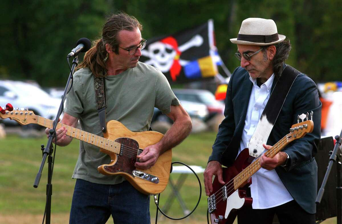 """DynaMojo guitarist John Nelson, left, and bassist Timothy """"Lucky"""" Topalian perform at Milford Arts Council's MAC Musicfest fundraiser at Eisenhower Park in Milford, Conn., on Saturday Oct. 10, 2020."""