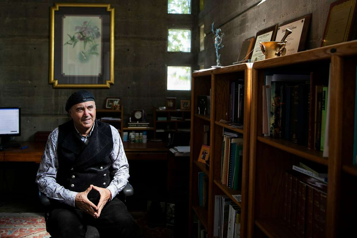 Homeopathic practitioner Dana Ullman, who uses the pronouns che/chis/chey, sits in chis office in Berkeley, Calif.