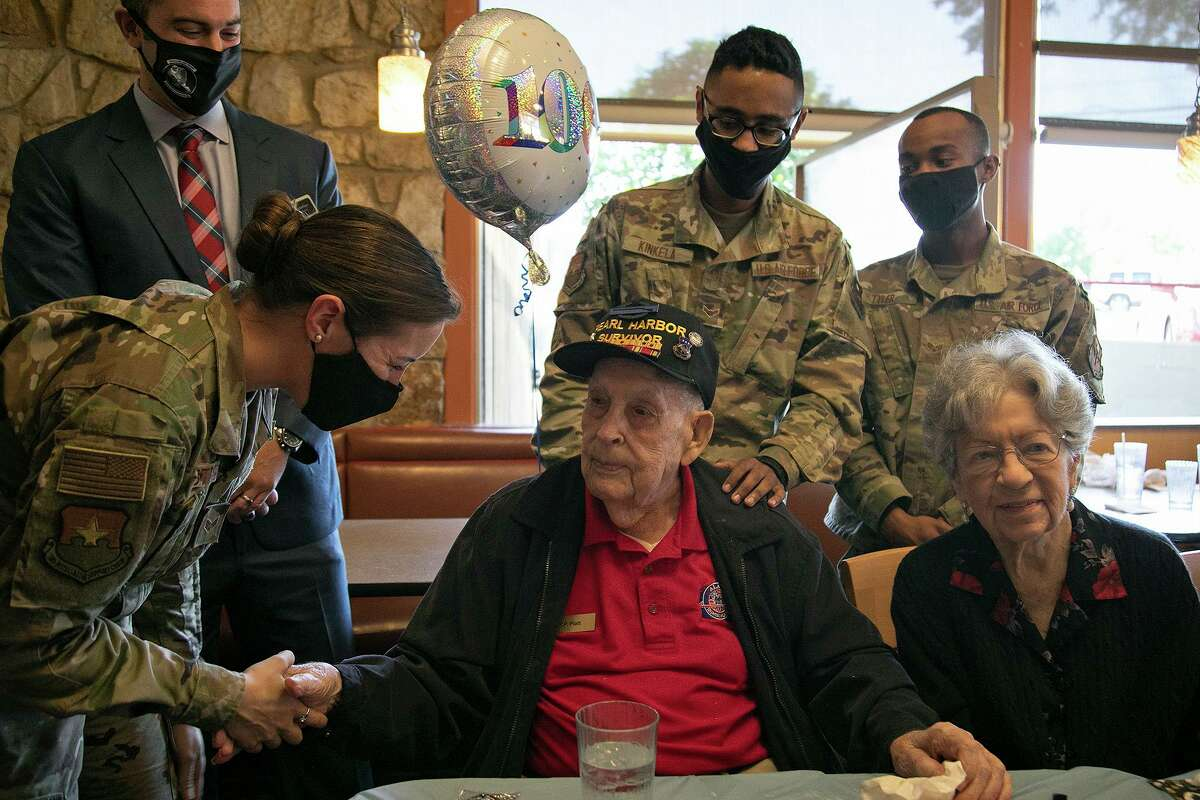 Senior Airman Margaret Mistretta, left, talks with Pearl Harbor veteran Kenneth Platt as he celebrates his 100th birthday with family, including his wife, Lorena Platt, right, and members of his Alamo Honor Flight breakfast group at Jim's Restaurant in San Antonio on Wednesday. Looking on are Brian Hoffman, vice director of the 502d Air Base Wing, from left, Airman First Class Jalen Kinkela and Senior Airman Malik Tyler.