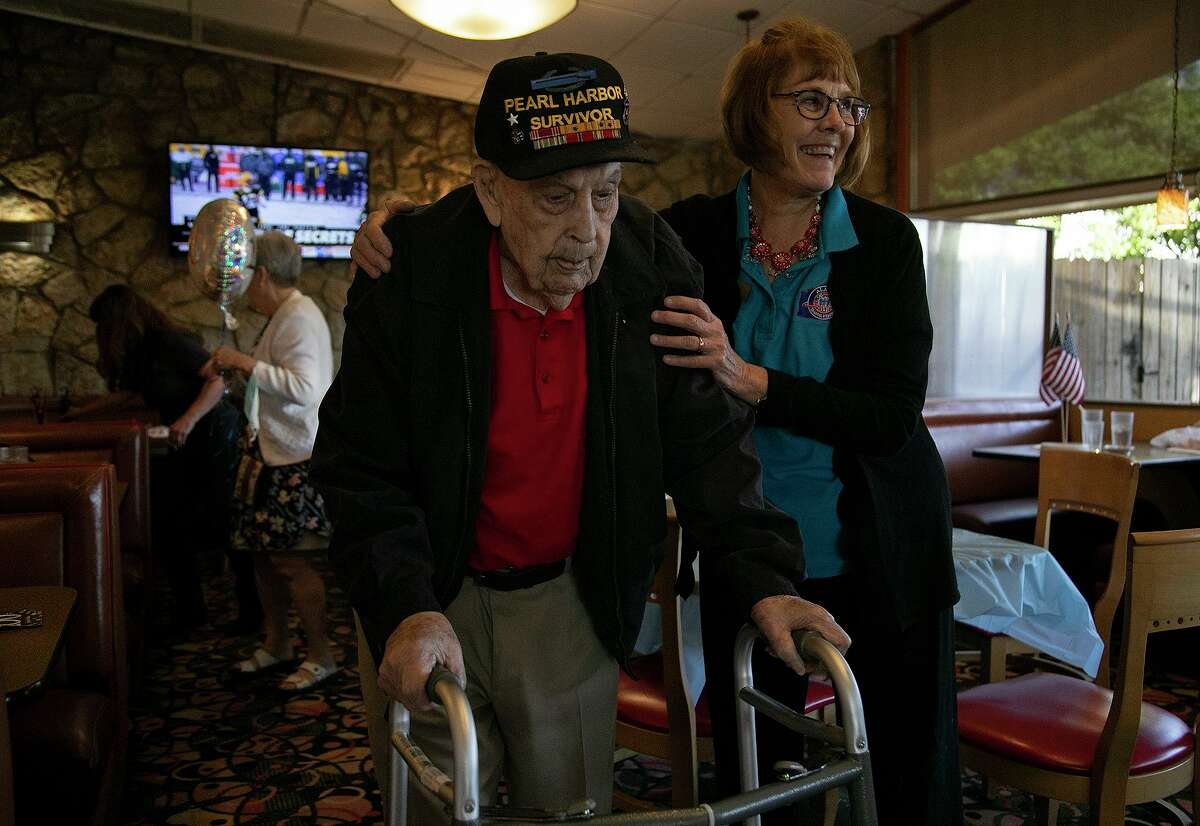 Elizabeth Montalvo, right, says goodbye to Pearl Harbor veteran Kenneth Platt after the celebration for his 100th birthday with family and members of his Alamo Honor Flight monthly breakfast group at a Jim's Restaurant in San Antonio on May 5, 2021.