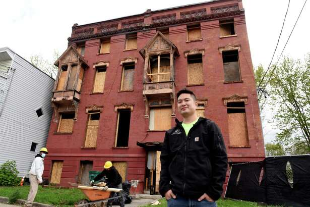 Patrick Chiou, president of Albany Management Group, stands outside one the Clinton Avenue properties that his group is renovating on Friday, April 30, 2021, in Albany, N.Y. (Will Waldron/Times Union)