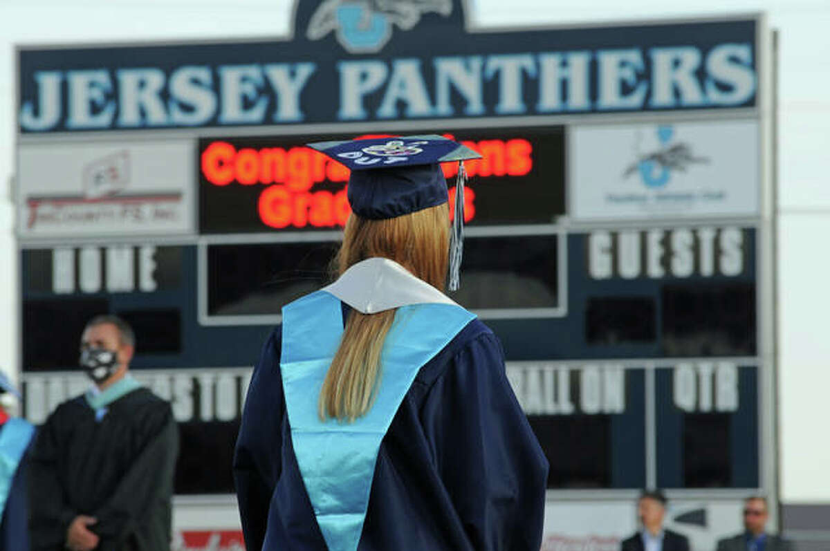 A Jersey Community High School graduate on Aug. 1 participates in one of the area's rare graduation ceremonies last year. This year school's are again planning ceremonies, many outdoors to provide for social distancing.