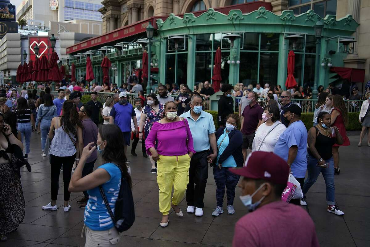 Visitors walk along the Las Vegas Strip in April.