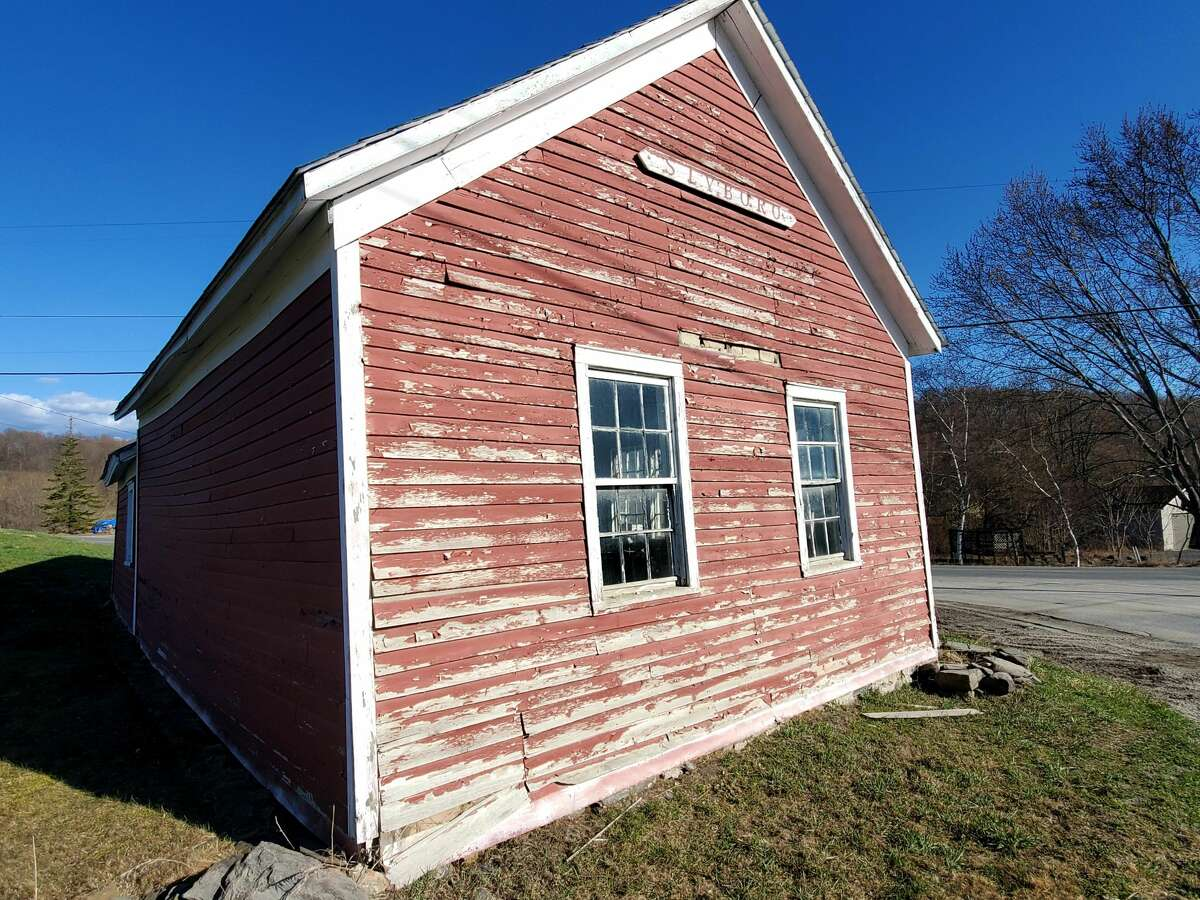 The Slyboro Schoolhouse is a one-room on Hick's Orchard in Granville. It is being restored by a teacher from New York City who left to escape COVID-19.