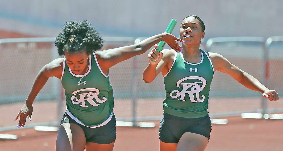 Reagan's Madeline hands off the baton to Taylen Wise in women's 4x100 6A. women's 4x1000 6A. McEloy Region IV-6A/5A at Heroes Stadium on Saturday, April 24, 2021