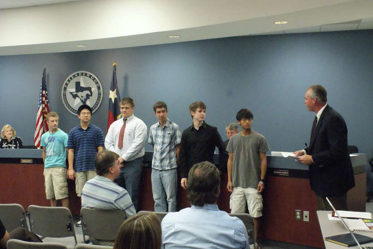 An engineer in the aerospace field, Mike Shaw said his roots in the Friendswood community aided him as a trustee in Friendswood ISD. Here, Shaw, right, presents awards in 2010 to students accepted into the Zero Robotics National Challenge held in conjunction with the MIT Space Systems Department and NASA.