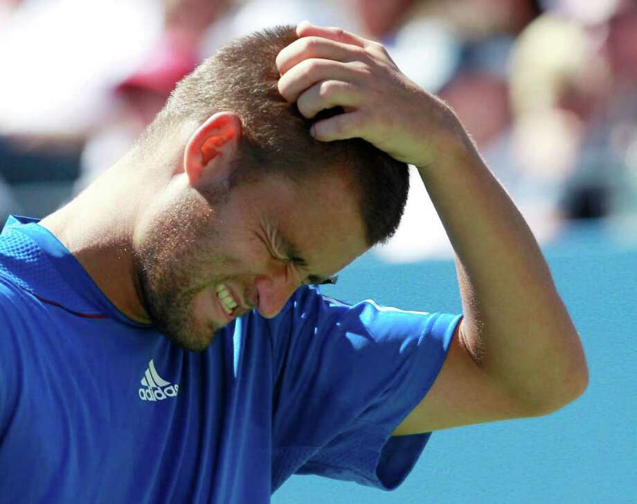Mikhail Youzhny, of Russia, reacts during the third set of a men's semifinal match against Rafael Nadal, of Spain, at the U.S. Open tennis tournament in New York, Saturday, Sept. 11, 2010. Photo: Charles Krupa