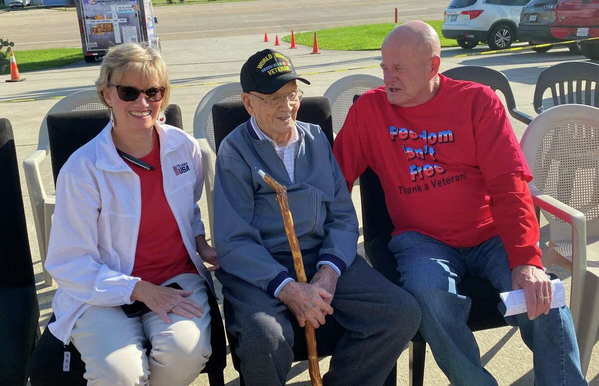 Lewis R. Shannon, 102, a World War II veteran, was honored at Storage 105 on Wednesday morning. A new American flag was raised and dedicated in Shannon's honor Wednesday. Pictured from left are Becky Schuster, daughter of Lewis Shannon, Lewis Shannon and Jack McClanahan, owner of Storage 105.