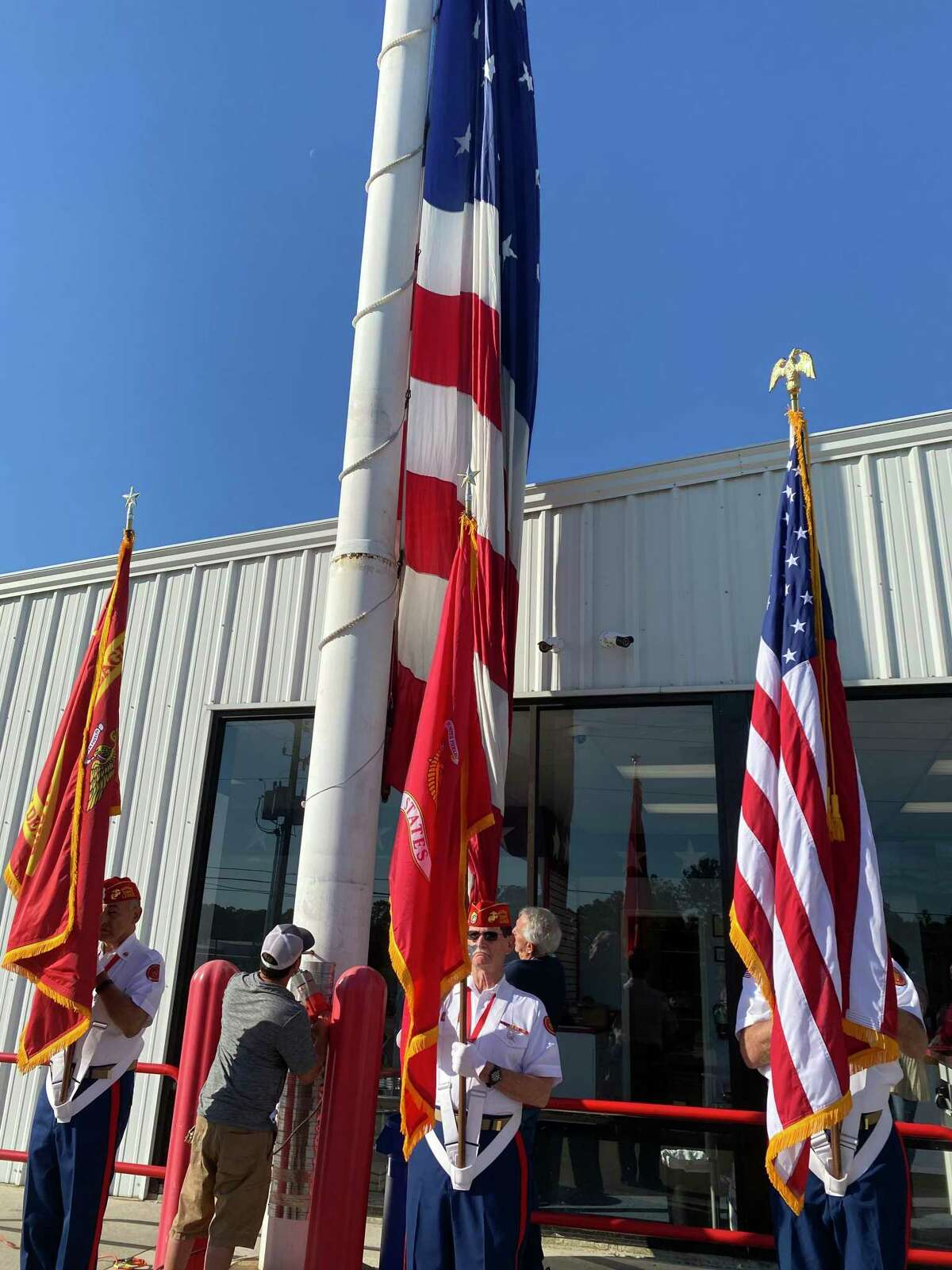 Lewis R. Shannon, 102, a World War II veteran, was honored at Storage 105 on Wednesday morning. A new American flag was raised and dedicated in Shannon's honor Wednesday.