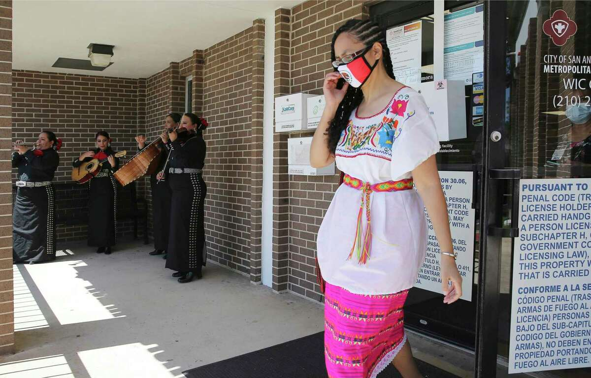 """Mariachi Las Altenas performers: Bobbie Garcia (from left), Alina Mallen, Vanessa Ortega and Director Valerie Vargas performas as Bexar County Precinct 1 Commissioner Rebeca Clay-Flores (right) on Wednesday, May 5, 2021 receives the Johnson & Johnson vaccine while hosting a Cinco de Mayo-themed COVID-19 vaccination event including musical performances from members of Mariachi Las Altenas at the University Health Zarzamora Clinic on the South Side. The commissioner received the one-shot Johnson & Johnson vaccine at the event and afterwards shared her experience to encourage others to step forward and be vaccinated. """"Cinco de Mayo"""" is an annual celebration held on May 5 in observance to commemorate the Mexican Army's victory over the French Empire at the Battle of Puebla, on May 5, 1862, under the leadership of General Ignacio Zaragoza. In keeping with this theme of victory, vaccinated residents will be celebrated with tamales as people were greeted with Mariachi music at the clinic."""