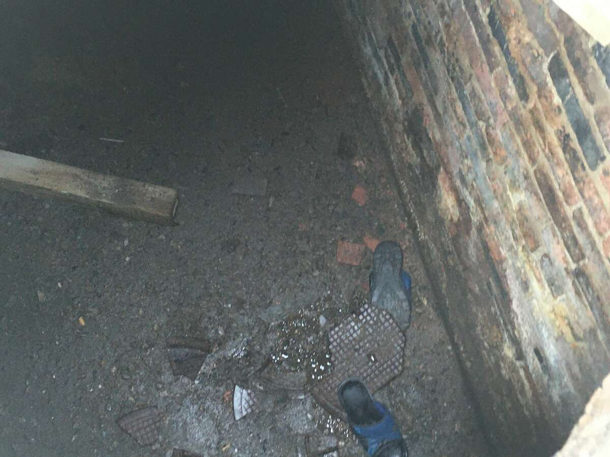 This is the manhole cover and underground area where a man came and went Sunday in Schenectady.