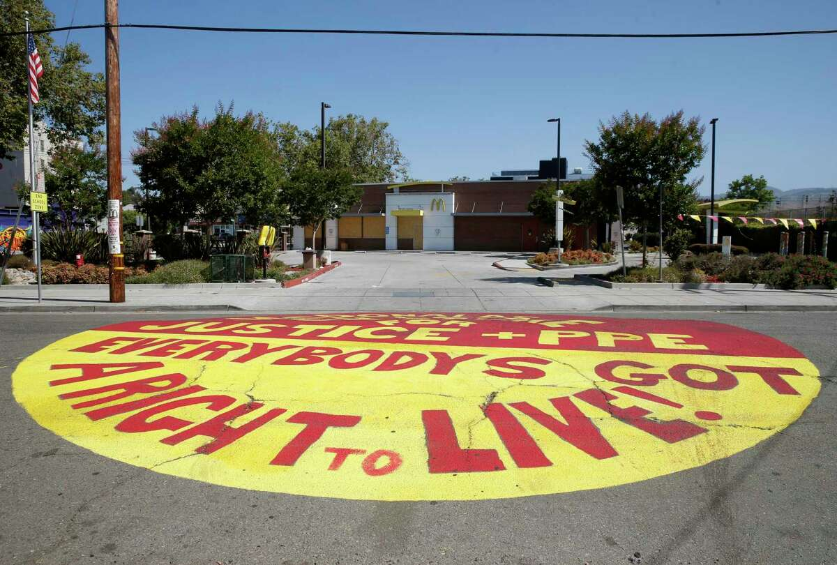 A message was painted on 45th Street in front of a McDonald's in Oakland in July, after employees contracted COVID-19.