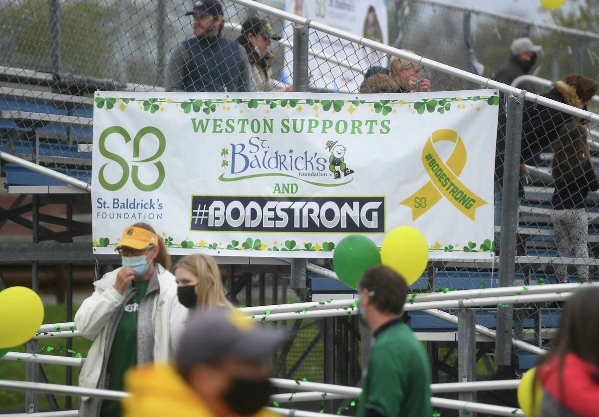 The Weston boys lacrosse game with Brookfeld raises money for the St. Baldrick's Foundation pediatric cancer research at Weston High School in Weston, Conn. on Monday, May 3, 2021. A group of 2021 Weston athletes, some of which are on the lacrosse team, founded the Weston St. Baldrick's club which has raised over 180 thousand dollars.
