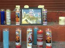 In this 2019 photo, a memorial to Michael Randall, who died in a fire on West Street after helping others get out of the burning home.