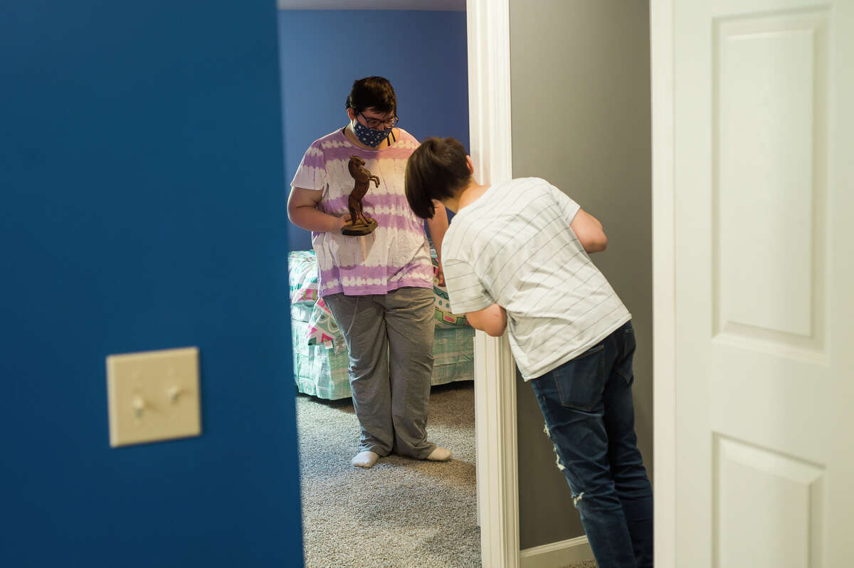 Bethann Billings, 17, and her sister Kristiena, 11, right, get their first look at their new bedrooms during an event celebrating the family's newly built home Wednesday, May 5, 2021 in Sanford. The home was built through a partnership between Habitat for Humanity and the United Way and their collaborative project,