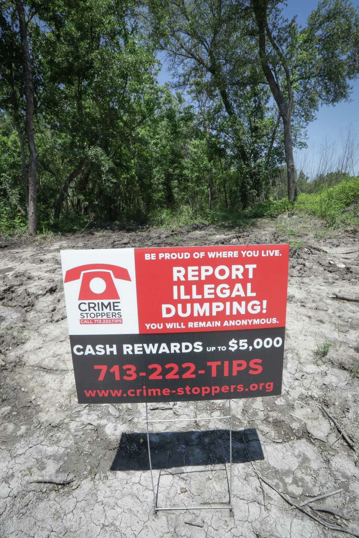 Illegal dumping prohibited signs are at a dead end off of W. Airport and Buffalo Speedway Wednesday, May 5, 2021, in Houston. City Council Member Martha Castex-Tatum said today she caught a city contractor illegally dumping tree waste in her district, using cameras her office and the 5 Corners Management District installed to catch dumpers.