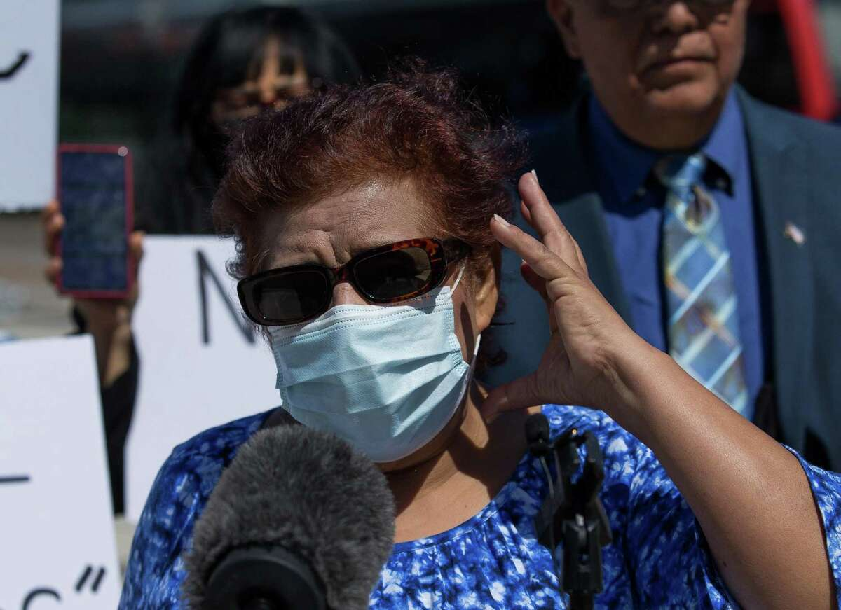 """Esperanza Ortiz, 63, talks to reporters about the attack she endured while on a Metropolitan Transit Authority train while heading to work on Feb. 11, during a press conference on May 5, 2021, in Houston. Ortiz was punched repeatedly in the head by a man who was yelling """"I hate Mexicans"""" during the attack. She says the Metro train operator offered no help."""