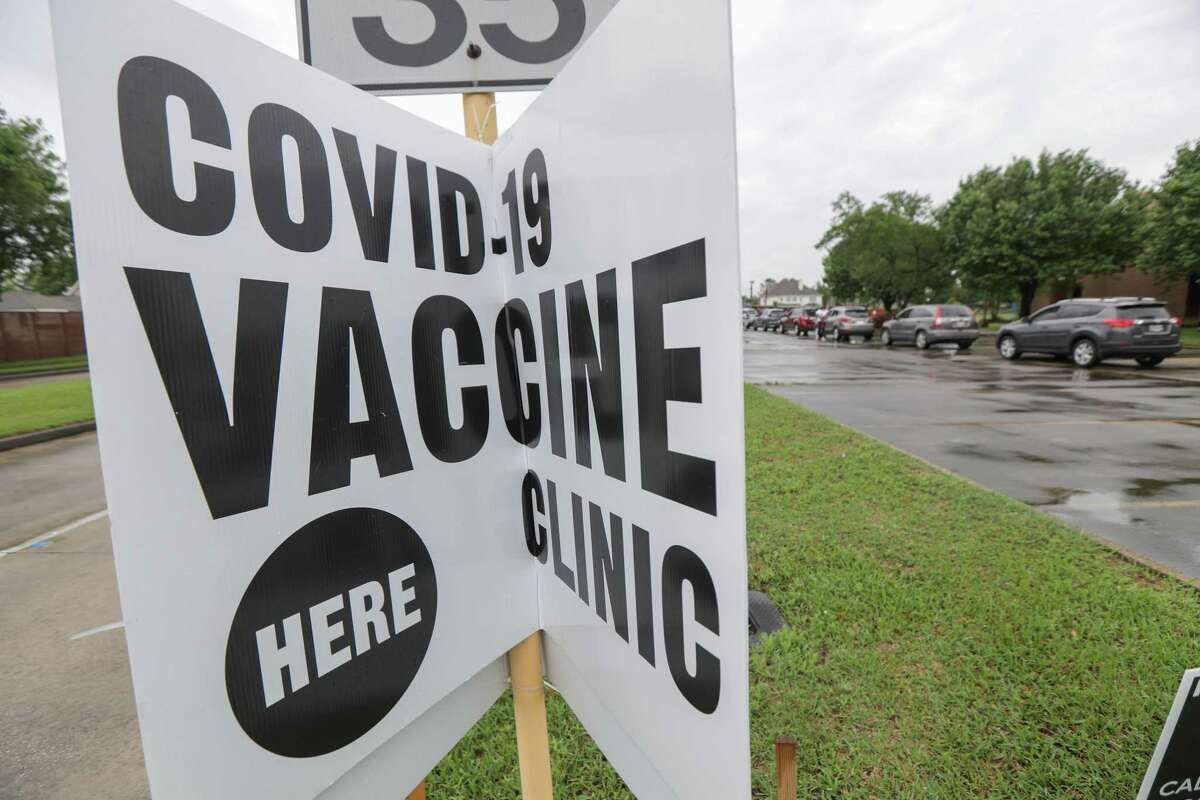 A sign notifies traffic of a COVID-19 vaccine clinic for the community at CrossRoads United Methodist Church Friday, April 30, 2021, in Houston.