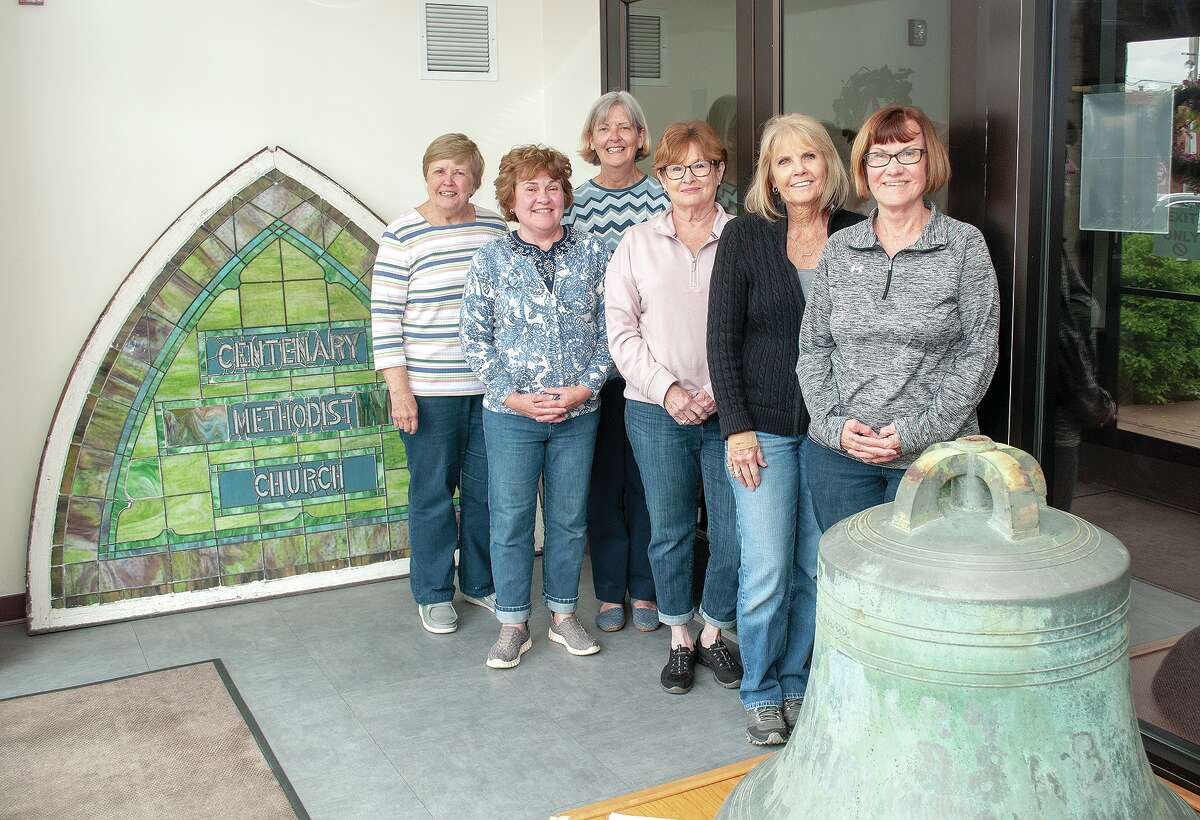 Centenary United Methodist Church members Debbie Belzer (from left), LuAnne Woodrum, Pat Manker, Peggy Jordan, Daphne Spradlin and Linda Tribble stand next to a stained glass window and the original bell from the church that was demolished in the late 1990s. Both will be displayed on the north side of the current church.