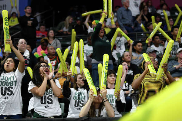 The Seattle Storm fans cheer their team on during the first game of the WNBA playoffs against the Minnesota Lynx at the Angel of the Winds Arena on September 11, 2019 in Everett, Washington.