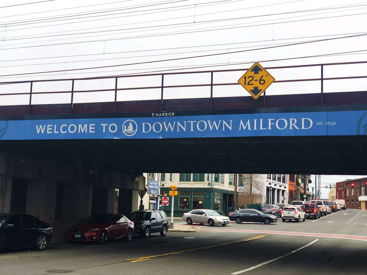 A sign on a bridge marking downtown Milford.