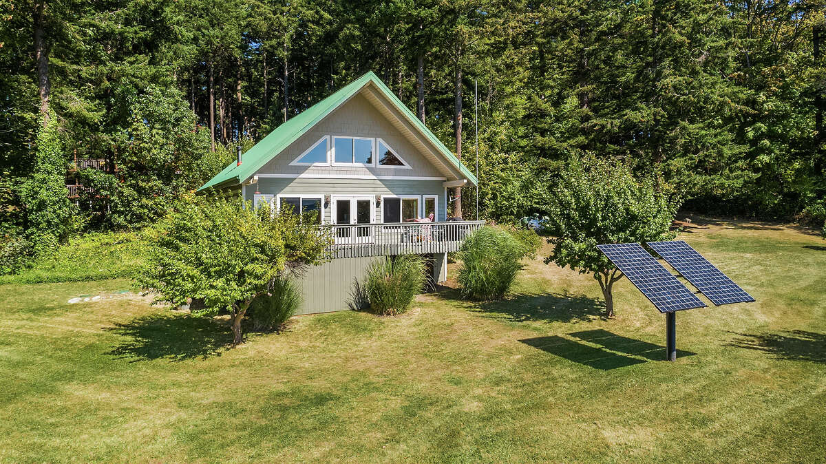 All yours: the cabin and its solar power, nestled on a wide lot.