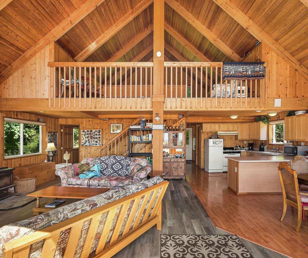 The cabin's A-frame/loft design hosts two bedrooms.