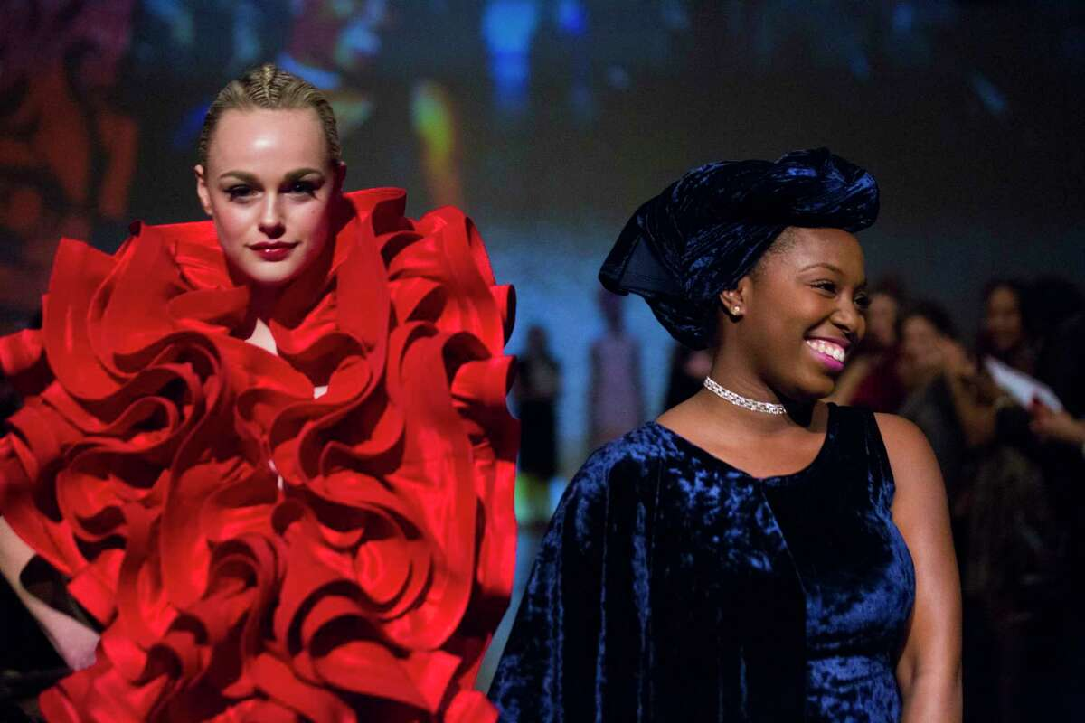 Ebonie Sophus next to her design called Oscar de la Ruffles at the Fashion Fusion 2018.