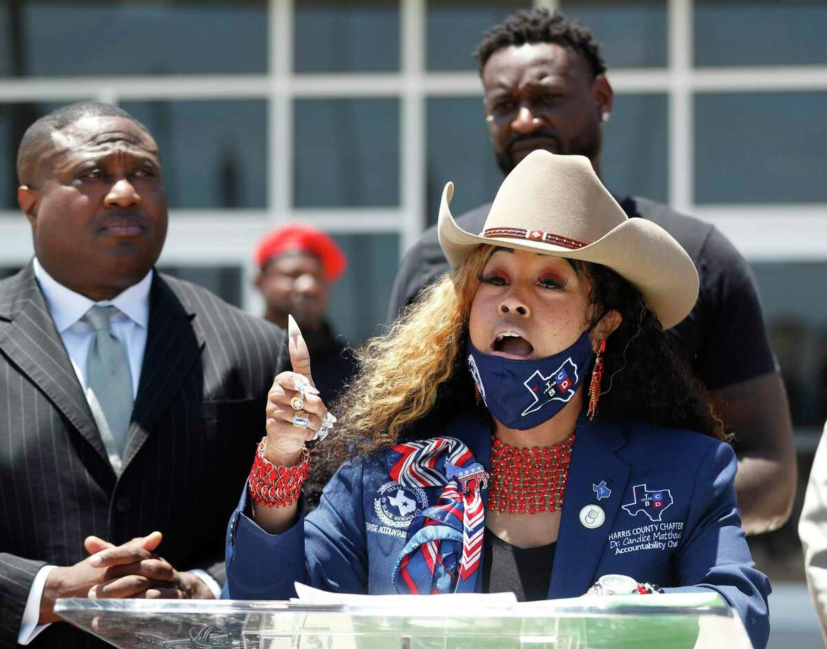 Dr. Candice Matthews, TCBD Accountability Statewide/Harris County Chair speaks to the media with Quanell X during a press conference at the Galveston Law Enforcement Center, Wednesday, May 5, 2021, in Galveston. The Texas Coalition Of Black Democrats organized a