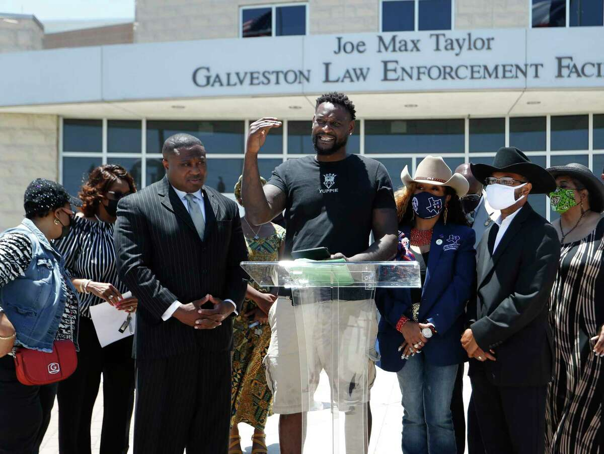 Andre Malone, a man who was tased and arrested during the recent Slab beach party in Galveston, is surrounded by Dr. Candice Matthews, TCBD Accountability Statewide/Harris County Chair, and Quanell X, during a press conference at the Galveston Police Department, Wednesday, May 5, 2021, in Galveston. The Texas Coalition Of Black Democrats organized a