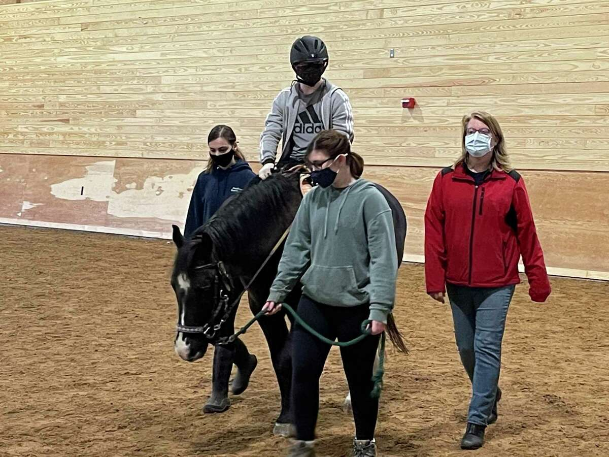 Gianna Campbell (Shepaug student volunteer), rider, Sophie Glickman (Shepaug student volunteer), Alice Daly. Rider is on Taz.