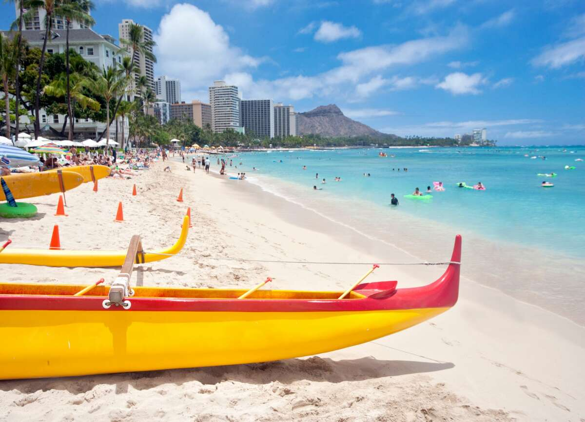 Waikiki Beach with outrigger canoes and Diamond Head in background. Waikiki, Honolulu, Oahu, Hawaii, USA