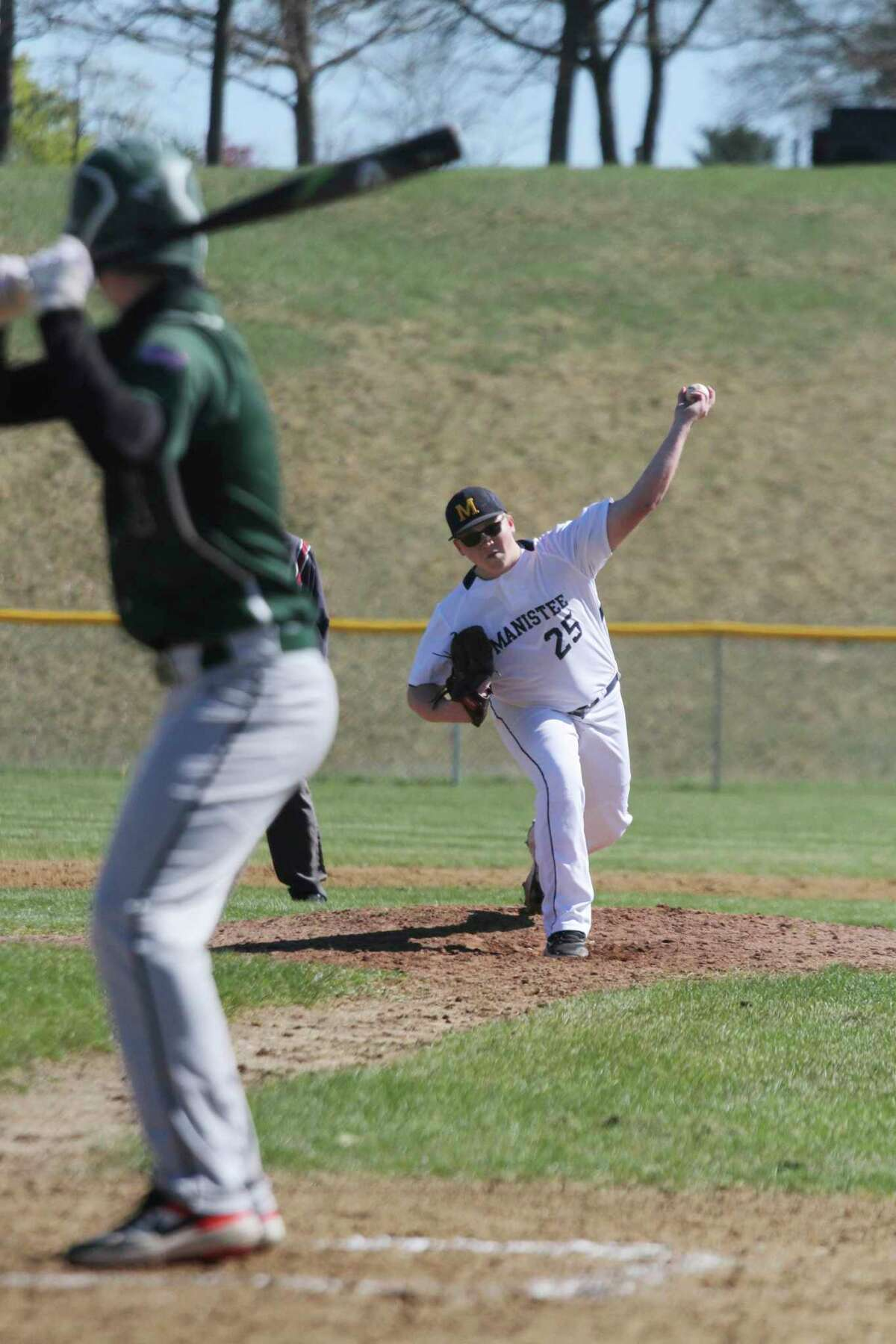 Manistee's Donavyn Kirchinger delivers a pitch during the Chippewas' doubleheader with Western Michigan Christian on Wednesday. (Dylan Savela/News Advocate)