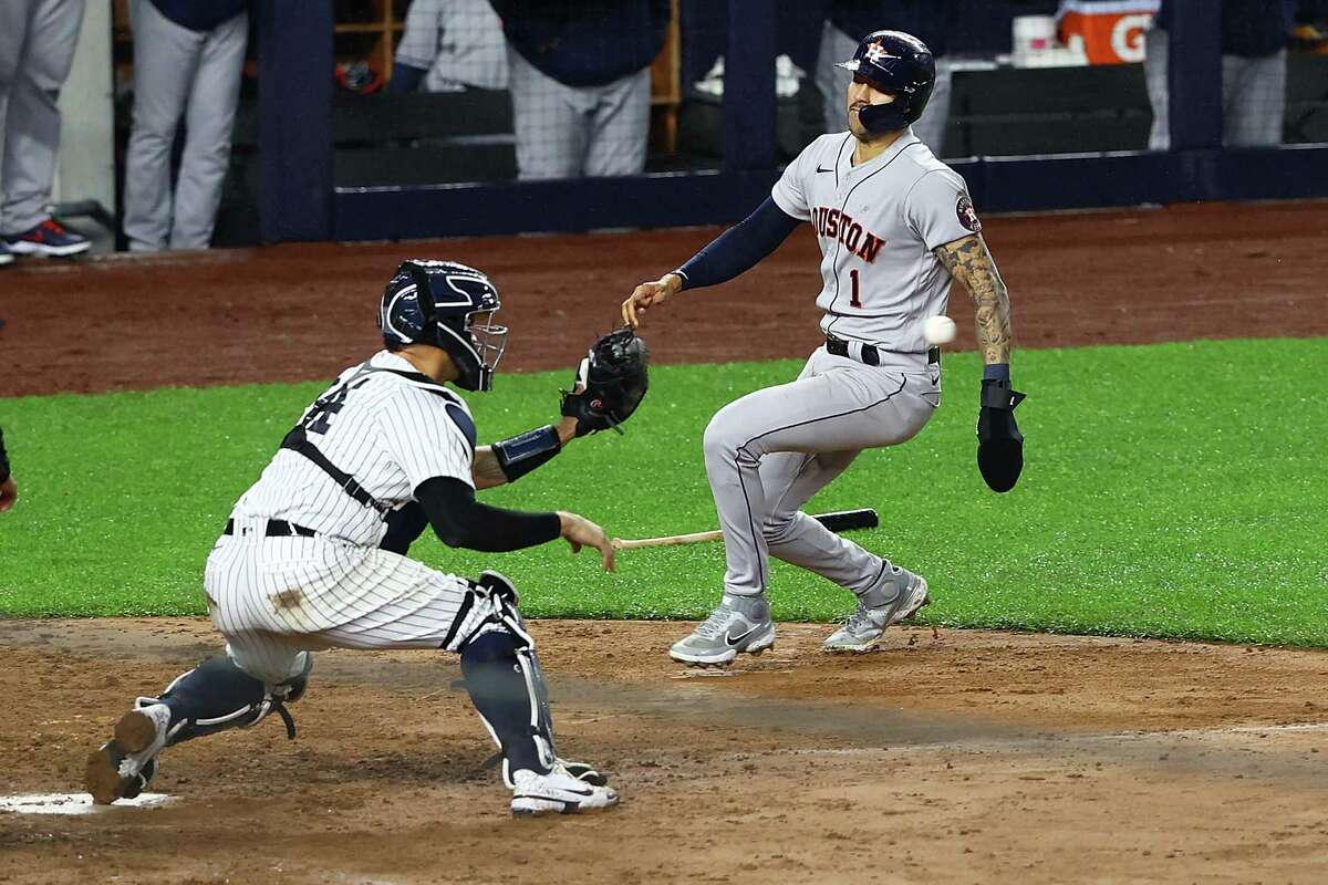 NEW YORK, NEW YORK - MAY 05: Carlos Correa #1 of the Houston Astros is tagged out by Gary Sanchez #24 of the New York Yankees trying to score on Yuli Gurriel #10 double to left field in the fourth inning at Yankee Stadium on May 05, 2021 in New York City.