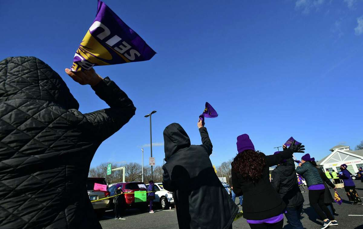 Members of SEIU local 32BJ join McDonald's franchise workers as they strike Tuesday, November 24, 2020, during an Rally & Caravan over safety concerns during the COVID spike and Thanksgiving travel season at the I-95 CT Northbound Service Plaza in Norwalk, Conn. Workers have been organizing with 32BJ SEIU to win union recognition, better treatment, pay and benefits.