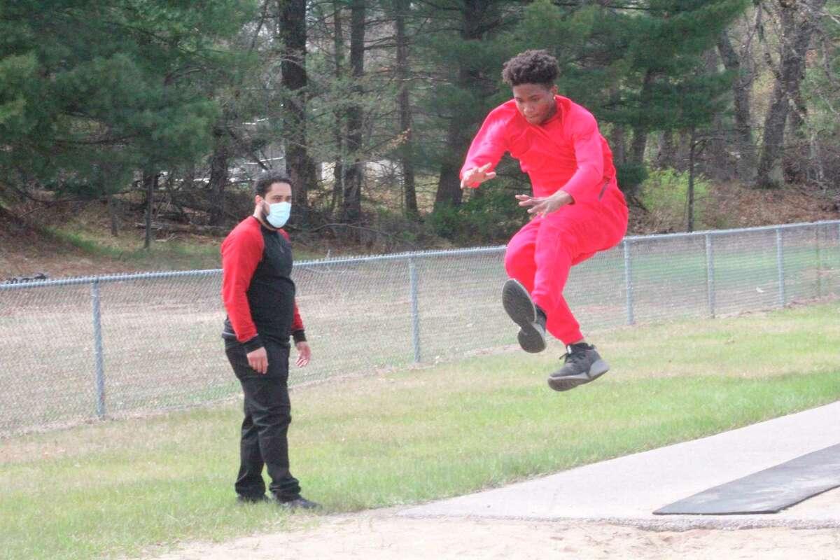 Baldwin junior high coach Nate Fricke watches as Delante Williams flies through the air during a practice last week. ((Star photo/John Raffel)
