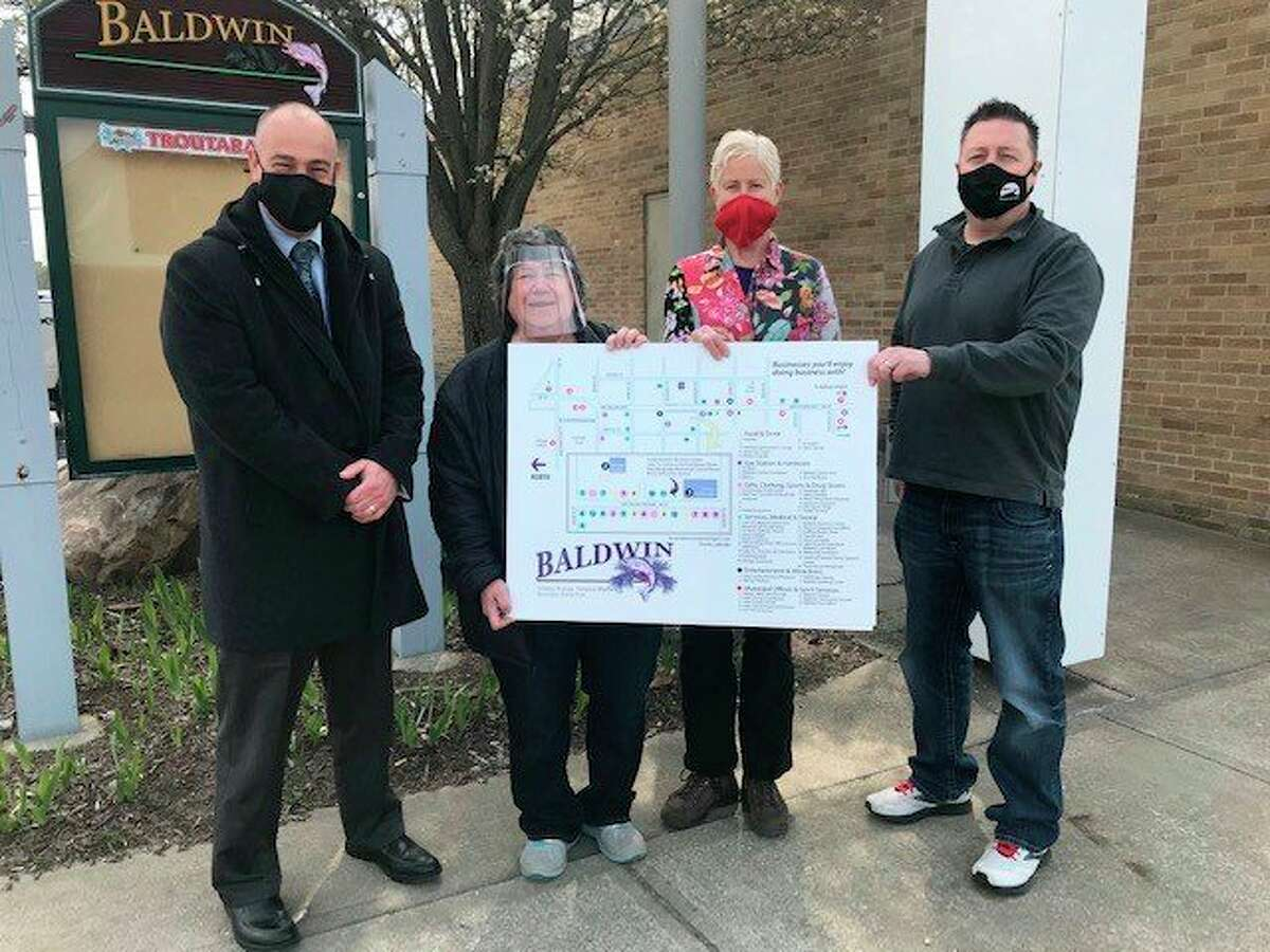 Holding the new sign (from left) is Dr. Jason Jeffrey, superintendent,West Shore ESD; Darci Maldonado, DDA Vice-Chair; Jane Allison, DDA Chair; Seth Wenger, DDA member, and President of the Lake County Community Foundation. (Submitted photo)